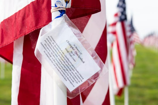 Biographies of the victims of the 9/11 attacks are attached to the flags at the 9/11 Memorial Healing Field at West Manheim Elementary School.