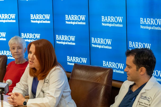 "Dr. Anna Burke, a director of the Alzheimer's and Memory Disorder Divison at Barrow Neurological Institute in Phoenix, speaks about the deep brain stimulation study during a press conference at Dignity Health St. Joseph's Hospital & Medical Center in Phoenix on Sept. 10, 2019. Burke is flanked by Dr. Francisco Ponce, a Barrow neurosurgeon and director of the Deep Brain Stimulation Program at Barrow, and patient Elizabeth ""Ann"" Alderson, who received a deep brain stimulation device at Barrow that acts like a ""pacemaker"" for her brain."