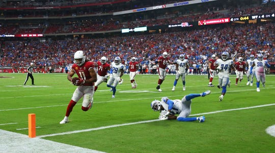 Arizona Cardinals wide receiver Larry Fitzgerald (11) catches a pass and scores a touchdown against the Detroit Lions in the second half during a game on Sep. 8, 2019 in Glendale, Ariz.