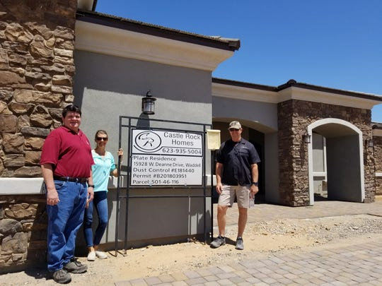 Owner Bill Plate with builder Gary Fetters and Vicki Connell, office manager of Castle Rock Homes.
