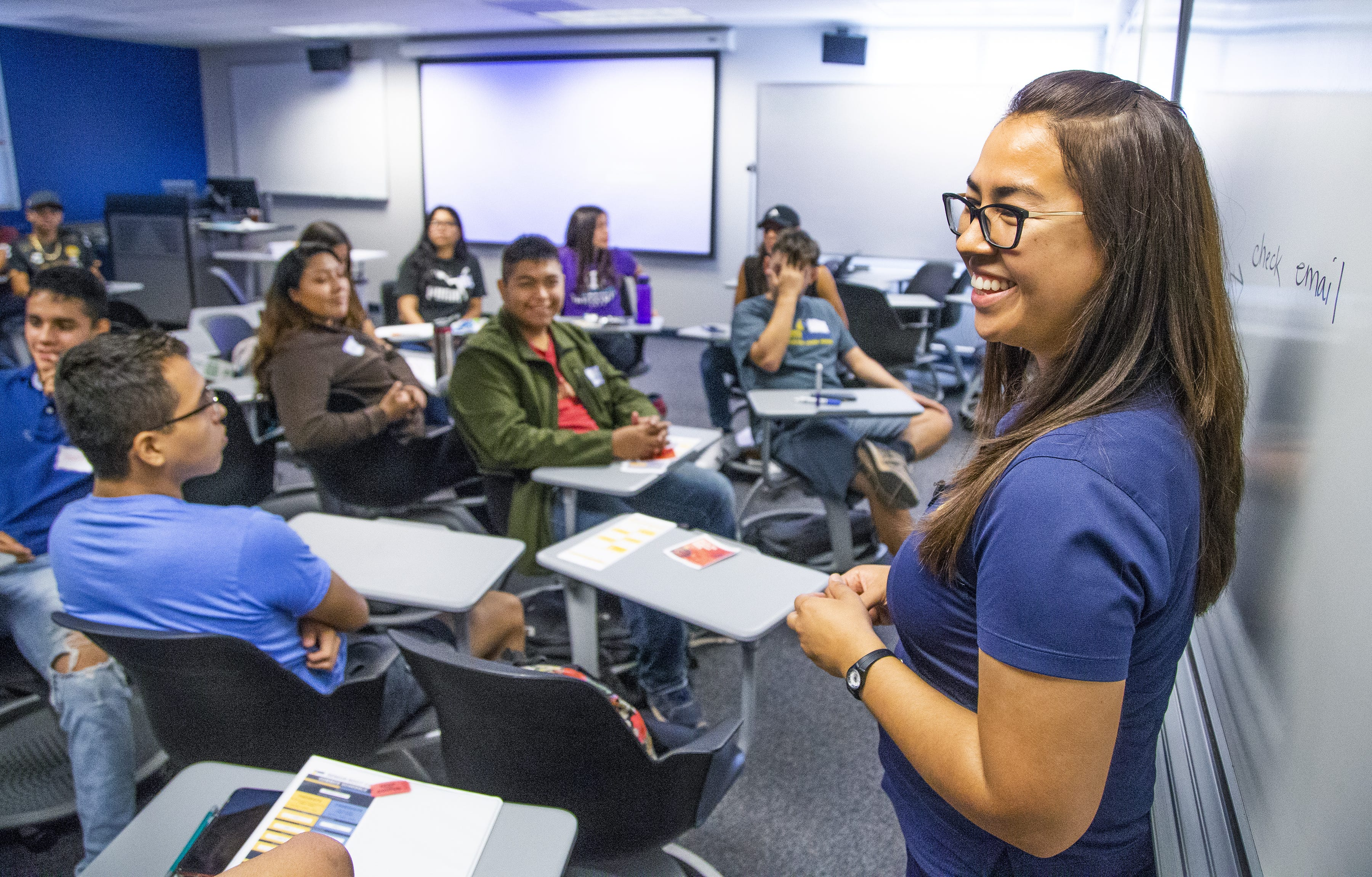 Jessica Solis, senior coordinator for college success programs for the Be A Leader Foundation, speaks to high school students at the college prep boot camp held at Phoenix College, Thursday, July 18, 2019.