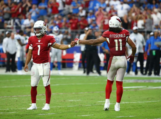 Arizona Cardinals quarterback Kyler Murray (1) react after wide receiver Larry Fitzgerald (11) catches a touchdown pas against the Detroit Lions in the second half during a game on Sep. 8, 2019 in Glendale, Ariz.