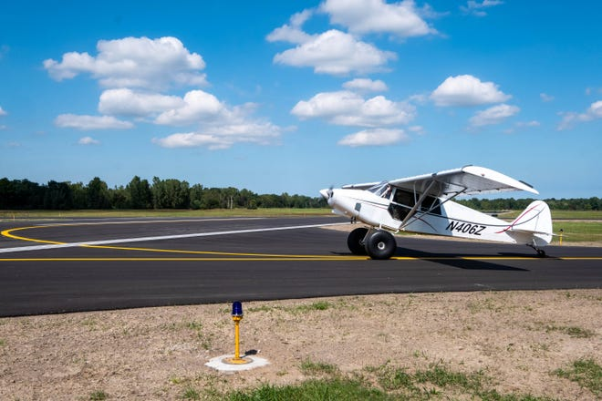 A small airplane rolls along the repaved taxiway at the St. Clair County International Airport Monday, Sept. 9, 2019. A round of improvements at the airport was funded through federal and state grants from the Federal Aviation Administration and the Michigan Department of Transportation Office of Aeronautics.