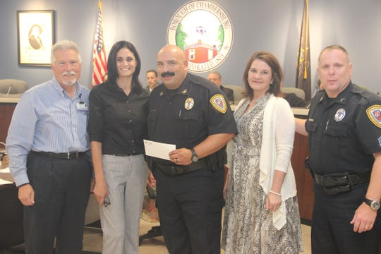 Officials from WellSpan Chambersburg Hospital present Chambersburg Police with a $25,000 donation at Monday evening's borough council meeting.  L to R: John Massimilla, Chief Operating Officer, WellSpan Chambersburg Hospital, Mannon Renzella, Nurse Manager, WellSpan Chambersburg Hospital Emergency Department, Chief Ron Camacho, Jill Harshman, Director of Patient Services, WellSpan Chambersburg Hospital, and Sergeant Jon Greenawalt, Chambersburg Police Department.