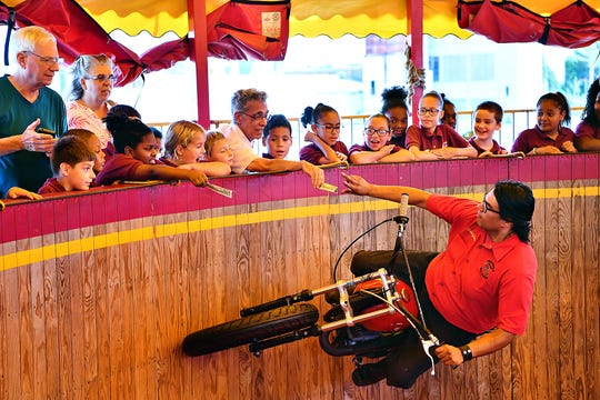 Edgar Fahs Smith STEAM Academy third and fourth graders look on from above during a performance in the Wild Wheels Thrill Arena at York Fair in West Manchester Township, Tuesday, Sept. 10, 2019. Dawn J. Sagert photo