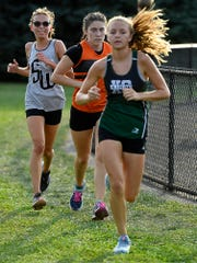 Morgan Dennison, right, of Fairfield, holds the lead over Courtney Ohl of York Suburban and Paige Watson of South Western during cross country at York Suburban High School, Tuesday, September 10, 2019.