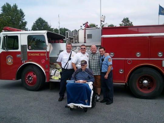 Several members of the York City Fire Department paid a visit to former Fire Chief George E. Kroll, Sr. on Friday, Sept. 6. Shown with fire engine 99-6 – purchased while George was fire chief – are (from left): York City Assistant Fire Chief David Ferguson; York City Fire Chief Chad Deardorff; George's son, George Kroll, Jr.; and York City Firefighter Jonathan Spencer.
