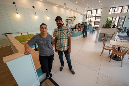 Co-owners Crystal Weaver, left, and Kyle Sollenberger take a break during a soft opening of the Prince Street Cafe on Continental Square in York.