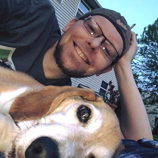 Aaron Lutes, with his beagle Buster, was a fixture at the Red Rose Restaurant & Lounge, helping people through tough times, including a shooting. He passed away, unexpectedly, last week at age 39.