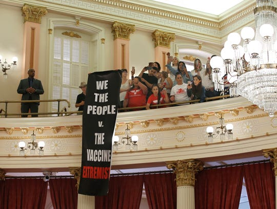 Opponents of recently passed legislation to tighten the rules on giving exemptions for vaccinations, demonstrate against a companion measure the state Senate gallery at the Capitol in Sacramento, Calif., Monday, Sept. 9, 2019. The state Assembly had approved the companion bill, Monday, with changes demanded by Gov Gavin Newsom as a condition of signing the controversial vaccine bill SB276 which was passed by the Legislature last week. The companion bill, SB714 still needs to be voted on by the Senate.(AP Photo/Rich Pedroncelli)