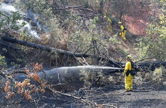 A vegetation fire burns south of China Gulch Drive off Canyon Road on Tuesday south of Redding. The fire was not threatening any structures.