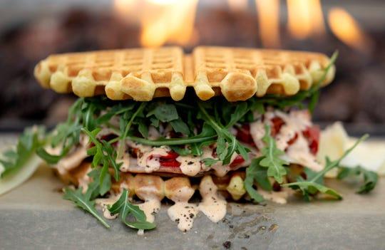 The Portland Press' Diablo Sandwich contains sliced turkey, ham, Gruyere, arugula, Mama Lil's peppers and garlic aioli.