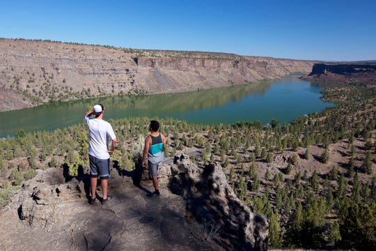 The Tam-a-lau Trail takes hikers up a steep canyon to views across Lake Billy Chinook and the Cascade Range.