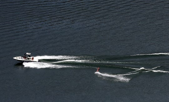 A water skier is pulled by a boat at Lake Billy Chinook.
