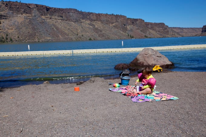 Rollie Urness, 2, plays at a beach at Lake Billy Chinook in Central Oregon.