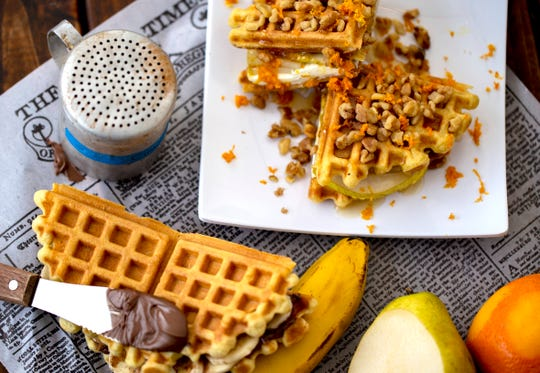 Figgy & The Pear (pear, cream cheese, fig jam, honey, walnuts and orange zest) and The Nutty Banana (Nutella, banana, honey and cinnamon) are two of The Portland Press' sweet waffle sandwiches.