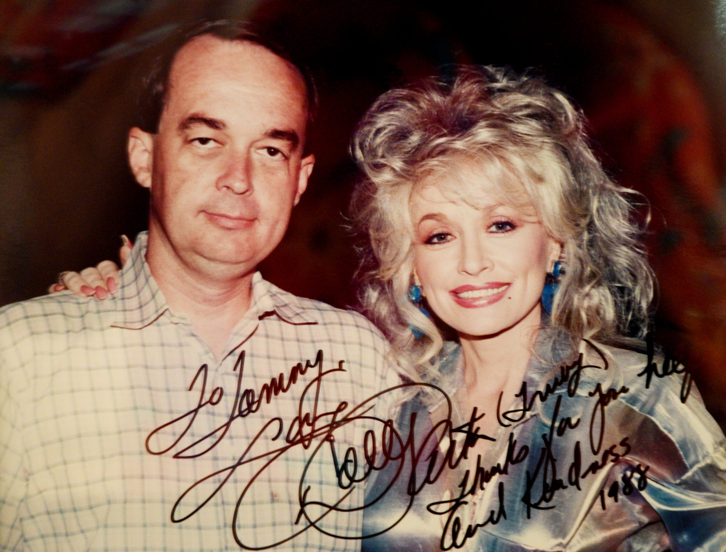 Tommy Whitehead's signed photo of the him and Dolly Parton when Steel Magnolias was filmed in Natchitoches.