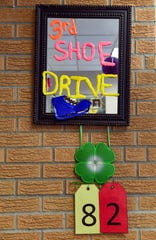 A sign at All City Elementary School shows that 82 bags of shoes have been packaged out of the goal of 300 for the third annual All City PTO shoe drive on Tuesday, September 10.