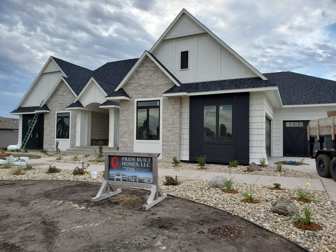 A home being featured in the 2019 Fall Parade of Homes at 47974 Prairie Hills Trail.