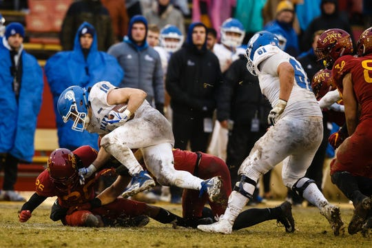 Drake running back Braeden Hartwig is tackled last  year in a 27-24 loss to Iowa State