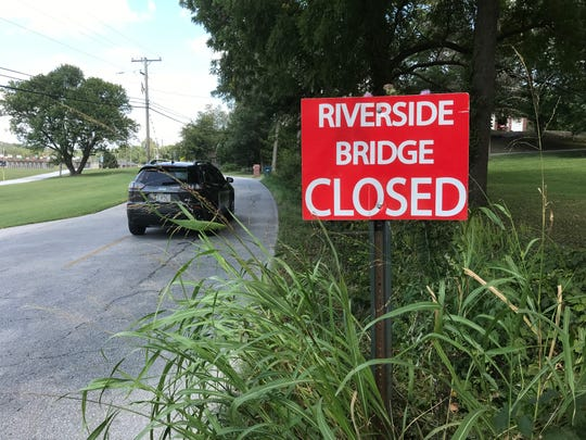 The Riverside Bridge no longer spans the Finley River north of Ozark. Where is the bridge? When will a new one be built?