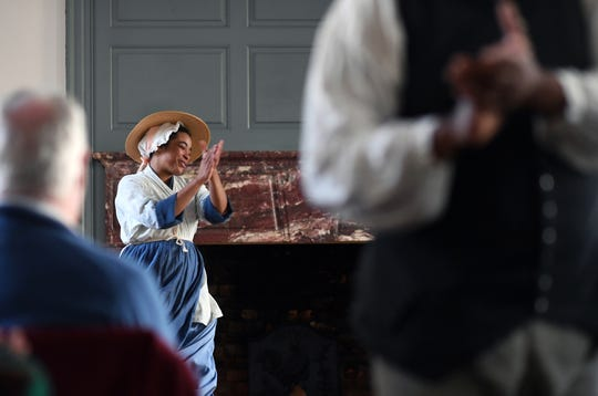 "Katrinah Carol Lewis takes part in a performance of ""Joy in the Morning"" at Colonial Williamsburg in February 2019 in Williamsburg, Va. The program illustrates the life of slaves in colonial times."
