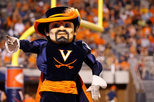 "Sep 6, 2019; Charlottesville, VA, USA; The Virginia Cavaliers mascot ""Cav Man"" dances on the field during a stoppgae in play in the third quarter against the William & Mary Tribe at Scott Stadium."