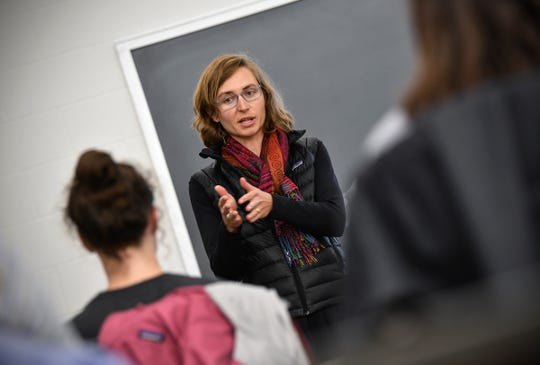 Corrie Grosse listens as students speaks during her Introduction to Environmental Studies class Monday, Sept. 9, 2019, at St. John's University in Collegeville.