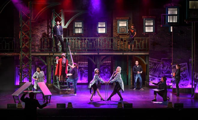 """Cast members, directors and behind-the-scenes production team members are pictured on the stage of GREAT Theatre's upcoming production of """"Chicago"""" during rehearsals Monday, Sept. 9, at the Paramount Theatre in St. Cloud."""