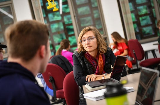Corrie Grosse listens as students share their ideas during her Introduction to Environmental Studies class Monday, Sept. 9, 2019, at St. John's University in Collegeville.