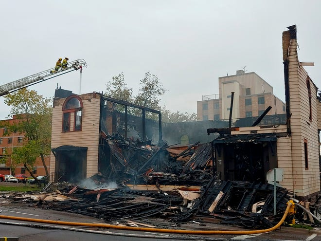 Firefighters work the scene of an overnight fire that engulfed and destroyed a synagogue in downtown Duluth, Minn., Monday, Sept. 9, 2019. (Brooks Johnson/Star Tribune via AP)