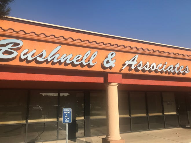 A sign advertises the offices of Bushnell & Associates in St. George on Monday, Sept. 9, 2019.