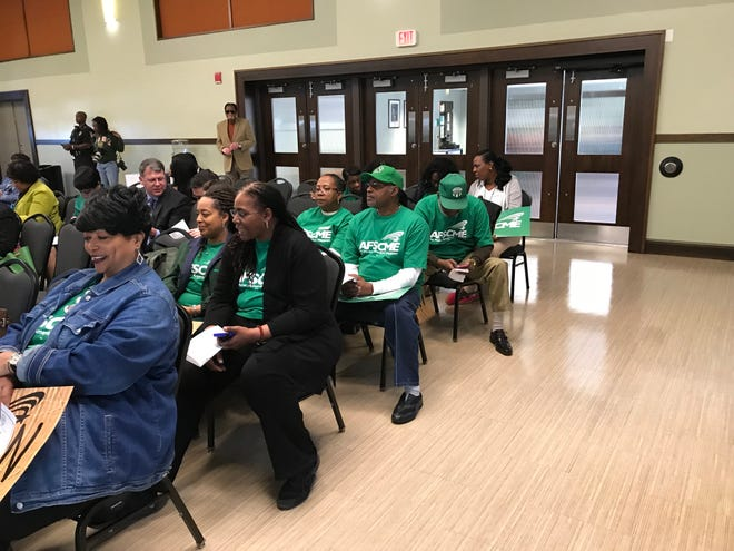 FAMU employees represented by AFSCME wearing green shirts attend Board of Trustees meeting earlier this year.