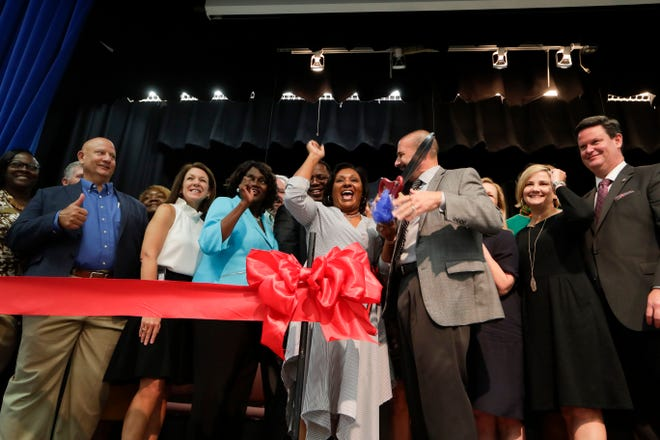 Sabal Palm Elementary School Principal Anicia Robinson and Leon County School Superintendent Rocky Hanna cut the ribbon introducing Sabal Palm Elementary School as a community partnership school Tuesday, Sept. 10, 2019.