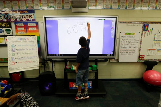 Fifth grader Nicholas Sanders does a math problem on the board in Mrs. Tamika Brown's math class at Sabal Palm Elementary School Tuesday, Sept. 10, 2019.