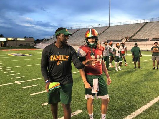 FAMU starting quarterback Ryan Stanley listens attentively to his position coach KJ Black.