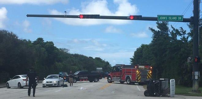 A golf cart and sedan crash on SR A1A on Tuesday, Sept. 10, 2019.