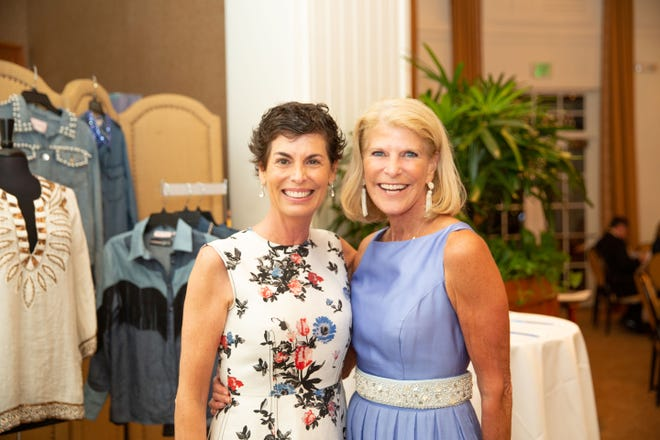 "Maureen Bauchman, left, and RoAnn Costin attend the Leukemia & Lymphoma Society's 2019 ""Illuminate"" gala at Quail Valley's River Club."