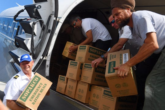 Missionary Flights International, a faith-based group in Fort Pierce, flew more than 7,000 pounds of much needed food, water, baby supplies and personal hygiene products to Freeport, the main city on Grand Bahama, on Monday. Sept. 9, 2019, a portion of the Bahamas ravaged by Hurricane Dorian. After offloading the humanitarian aid, about 20 Bahamians and one dog seeking refuge from the storm-tattered island were transported back to the Treasure Coast International Airport and Business Park in Fort Pierce where they were greeted by friends and family.