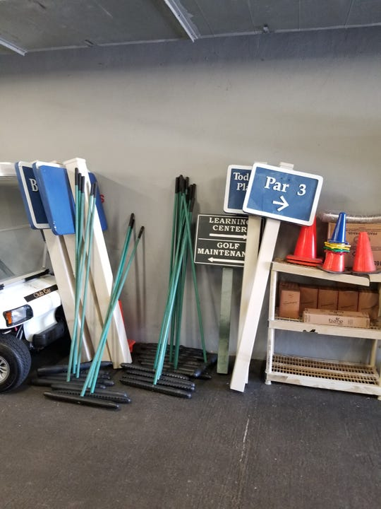 The signage from Quail Valley Golf Club in Vero Beach is placed in storage in preparation of Hurricane Dorian.