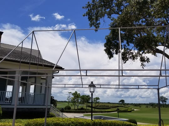 The bag stand tent at Quail Valley Golf Club in Vero Beach is taken down in preparation of Hurricane Dorian.