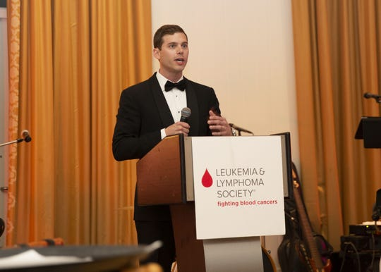 "Alexander Basse talks to the crowd at the Leukemia & Lymphoma Society's ""Illuminate"" gala about the importance of research. Alexander's mother, Maureen Bauchman, is a blood cancer warrior, he said."