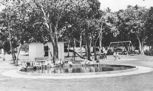 This wading pool in Pocahontas Park was a popular gathering place for youngsters in the mid-1930s. The pool took its toll however, because some of the children using it received injuries when there was any roughhousing. It was later demolished.