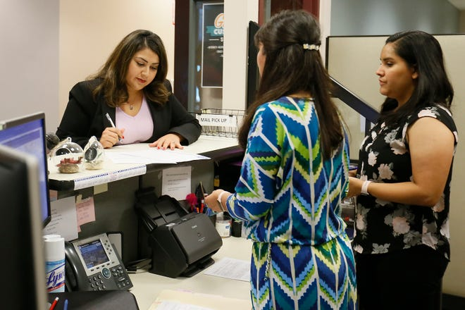 El Paso East-Central city Rep. Cassandra Hernandez files to run in a special election for her seat Tuesday, Sept. 10, 2019, at El Paso City Hall. City Clerk Laura Printe and senior secretary Angel Rocha helped Hernandez file her paperwork.