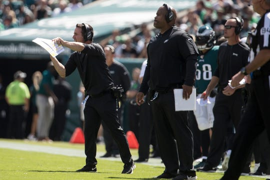 Philadelphia Eagles wide receiver coach Carson Walch gives instructions from the sideline Sunday at Lincoln Financial Field.