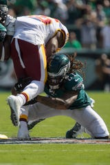 Eagles' Ronald Darby (21) goes low for a tackle Sunday, Sept. 8, 2019 at Lincoln Financial Field.