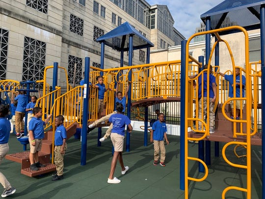 Kuumba Academy Charter School students play on the new playground outside the Community Education Building.