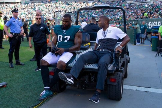 Malik Jackson #97 of the Philadelphia Eagles is carted off into the locker room in the fourth quarter against the Washington Redskins at Lincoln Financial Field Sunday in Philadelphia.