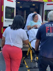 Collazo being put into an ambulance right after her daughter Amoura Rose was born in the bathroom of her sister's house in Wilmington on Aug. 25.