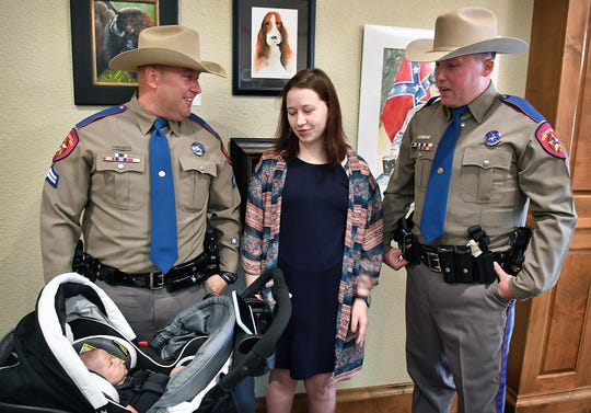 Kaylea Butts talks about her new baby with Texas DPS Corporal Joshua Moer, left, and Trooper Aaron Clopton following an awards ceremony Tuesday at The Forum. Moer and Clopton saved her life as she was being stabbed by her kidnapper in April 2018.